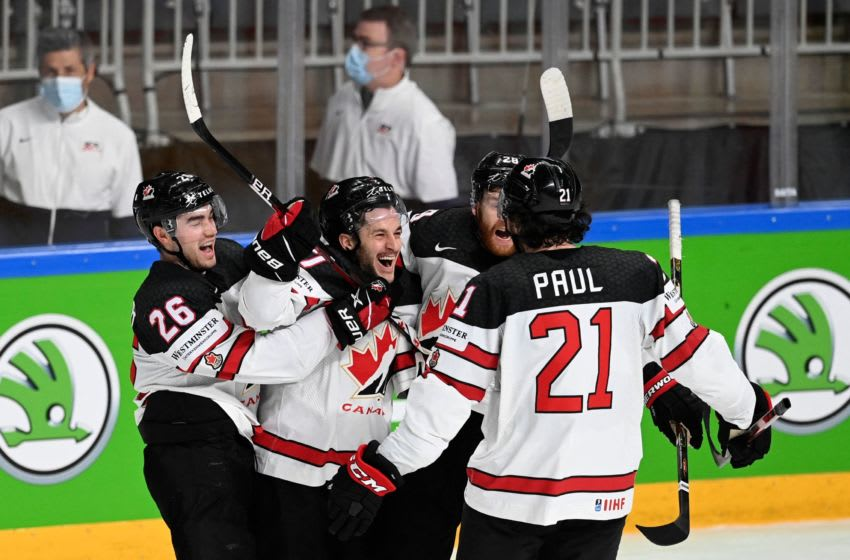 Canada's forward Justin Danforth (2L) celebrates with teammates (LtoR) Canada's defender Sean Walker, Canada's forward Connor Brown and Canada's forward Nick Paul after scoring the 2-4 goal for Canada during the IIHF Men's Ice Hockey World Championships semi-final match between the USA and Canada at the Arena Riga in Riga, Latvia, on June 5, 2021. (Photo by Gints IVUSKANS / AFP) (Photo by GINTS IVUSKANS/AFP via Getty Images)