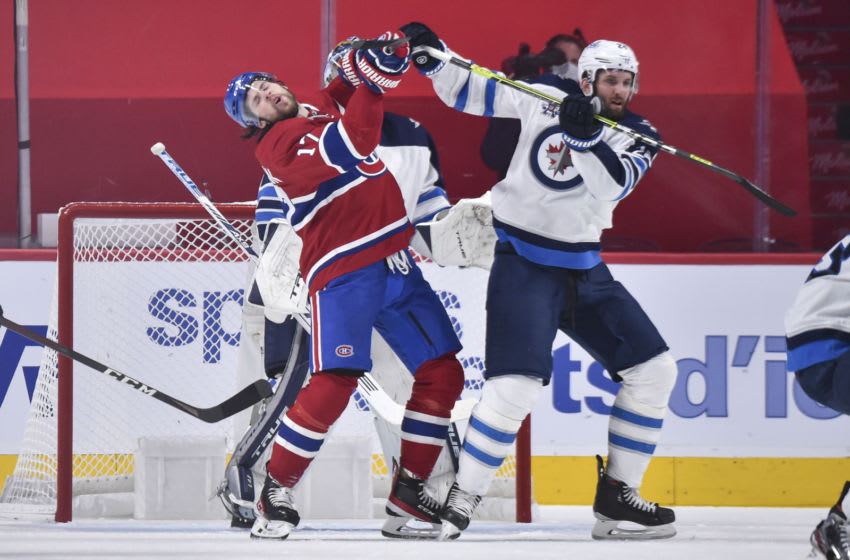 MONTREAL, QC - JUNE 06: Josh Anderson #17 of the Montreal Canadiens and Derek Forbort #24 of the Winnipeg Jets battle for position during the first period in Game Three of the Second Round of the 2021 Stanley Cup Playoffs at the Bell Centre on June 6, 2021 in Montreal, Canada. (Photo by Minas Panagiotakis/Getty Images)