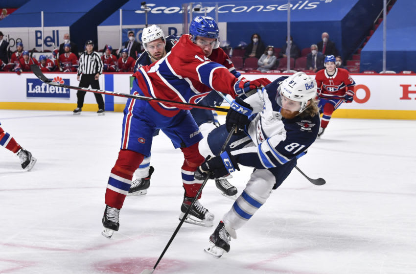MONTREAL, QC - JUNE 07: Nick Suzuki #14 of the Montreal Canadiens pushes Kyle Connor #81 of the Winnipeg Jets during the second period in Game Four of the Second Round of the 2021 Stanley Cup Playoffs at the Bell Centre on June 7, 2021 in Montreal, Canada. (Photo by Minas Panagiotakis/Getty Images)