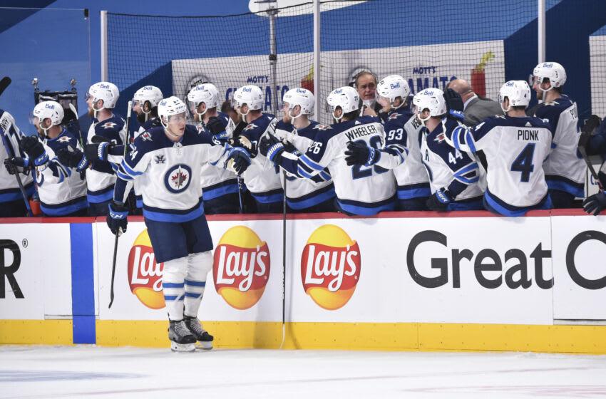 Logan Stanley #64, Winnipeg Jets (Photo by Minas Panagiotakis/Getty Images)