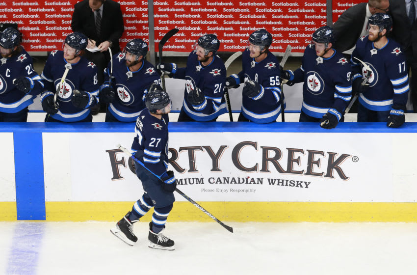 EDMONTON, ALBERTA - JULY 29: Nikolaj Ehlers #27 of the Winnipeg Jets celebrates scoring a second period goal against the Vancouver Canucks in an exhibition game prior to the 2020 NHL Stanley Cup Playoffs at Rogers Place on July 29, 2020 in Edmonton, Alberta. (Photo by Jeff Vinnick/Getty Images)