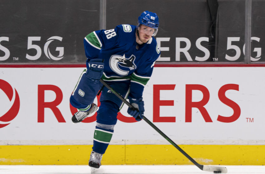 VANCOUVER, BC - JANUARY 20: Nate Schmidt #88 of the Vancouver Canucks passes the puck during NHL hockey action against the Montreal Canadiens at Rogers Arena on January 20, 2021 in Vancouver, Canada. (Photo by Rich Lam/Getty Images)