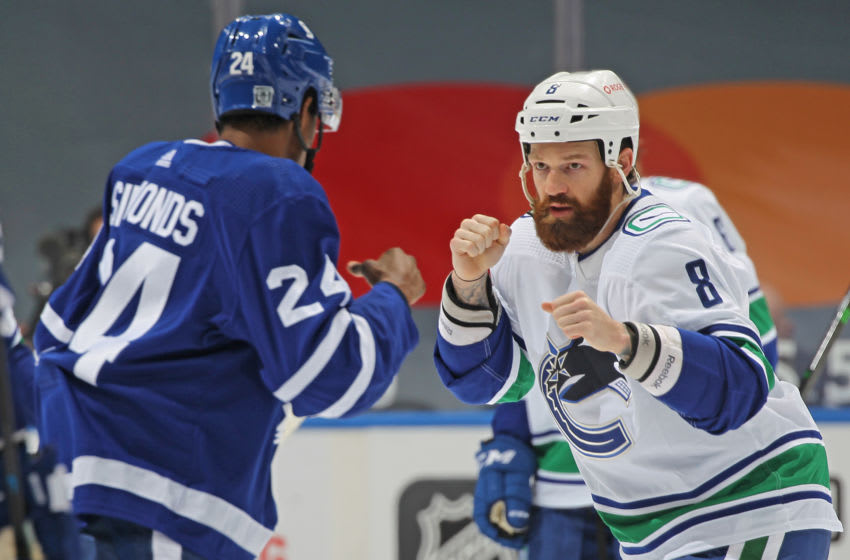 TORONTO, ON - FEBRUARY 4: Jordie Benn #8 of the Vancouver Canucks and Wayne Simmonds #24 of the Toronto Maple Leafs get set to trade punches during an NHL game at Scotiabank Arena on February 4, 2021 in Toronto, Ontario, Canada. The Maple Leafs defeated the Canucks 7-3.(Photo by Claus Andersen/Getty Images)