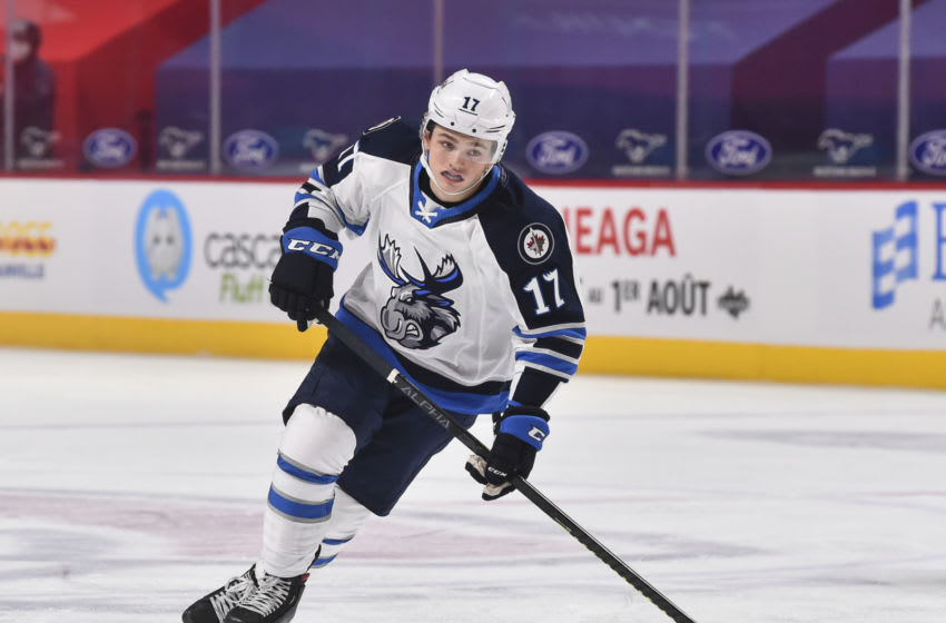 MONTREAL, QC - FEBRUARY 22: Cole Perfetti #17 of the Manitoba Moose skates against the Laval Rocket during the third period at the Bell Centre on February 22, 2021 in Montreal, Canada. The Manitoba Moose defeated the Laval Rocket 3-2 in overtime. (Photo by Minas Panagiotakis/Getty Images)