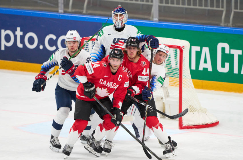 RIGA, LATVIA - MAY 23: (L-R) Matt Hellickson #55, Jake Oettinger #29 and Jack Drury #18 of the United States fight for position against Adam Henrique #14 and Maxime Comtois #44 of Canada during the 2021 IIHF Ice Hockey World Championship group stage game between Canada and the United States at Arena Riga on May 23, 2021 in Riga, Latvia. The United States defeated Canada 5-1. (Photo by EyesWideOpen/Getty Images)