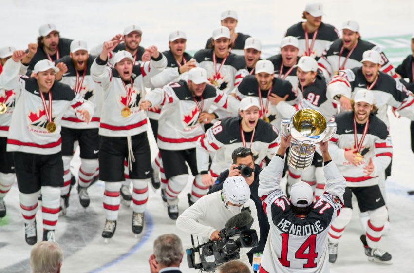 RIGA, LATVIA - JUNE 06: Adam Henrique #14 of Canada lifts the trophy after the 2021 IIHF Ice Hockey World Championship Gold Medal Game between Canada and Finlandat Arena Riga on June 6, 2021 in Riga, Latvia. Canada defeated Finland 3-2. (Photo by EyesWideOpen/Getty Images)