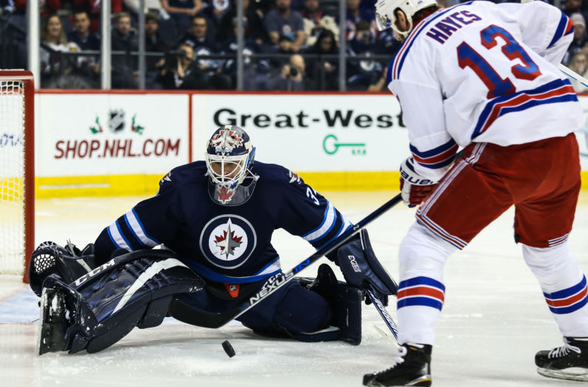 WINNIPEG, MB - DECEMBER 08: Jets Michael Hutchinson (34) stops Rangers Kevin Hayes (13) during the NHL game between the Winnipeg Jets and the Dallas Stars on December 08, 2016 at the MTS Centre in Winnipeg MB. (Photo by Terrence Lee/Icon Sportswire via Getty Images)