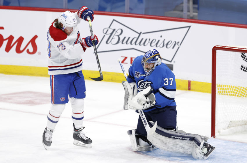 Mar 17, 2021; Winnipeg, Manitoba, CAN; Winnipeg Jets goaltender Connor Hellebuyck (37) blocks a shot by Montreal Canadiens center Tyler Toffoli (73) in the first period at Bell MTS Place. Mandatory Credit: James Carey Lauder-USA TODAY Sports
