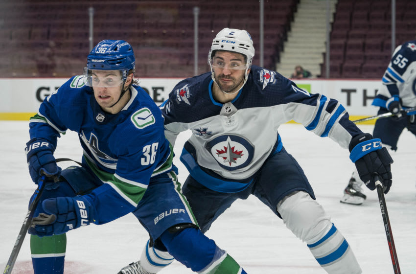 Mar 22, 2021; Vancouver, British Columbia, CAN; Winnipeg Jets defenseman Dylan DeMelo (2) skates against Vancouver Canucks forward Nils Hoglander (36) in the third period at Rogers Arena. Winnipeg won 4-0. Mandatory Credit: Bob Frid-USA TODAY Sports