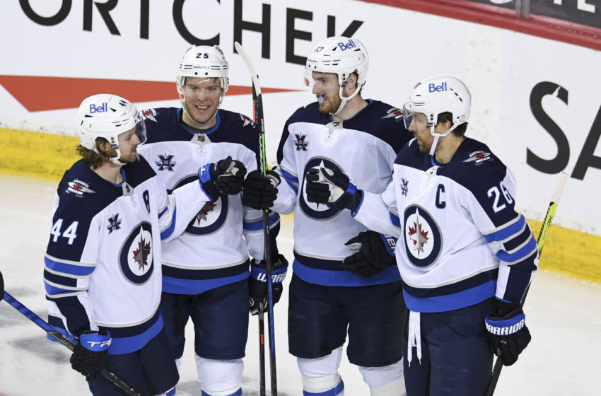 Mar 29, 2021; Calgary, Alberta, CAN; Winnipeg Jets forward Pierre-Luc Dubois (13) celebrates after scoring a third period goal against the Calgary Flames at Scotiabank Saddledome. The Jets won 5-1. Mandatory Credit: Candice Ward-USA TODAY Sports