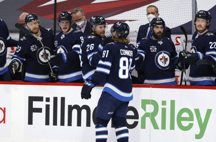 Apr 5, 2021; Winnipeg, Manitoba, CAN; Winnipeg Jets left wing Kyle Connor (81) celebrates his second period goal against the Ottawa Senators at Bell MTS Place. Mandatory Credit: James Carey Lauder-USA TODAY Sports