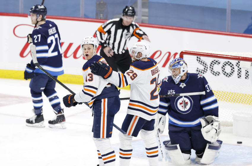 Apr 17, 2021; Winnipeg, Manitoba, CAN; Edmonton Oilers right wing Jesse Puljujarvi (13) celebrates his goal against the Winnipeg Jets with Edmonton Oilers center Leon Draisaitl (29) during the third period at Bell MTS Place. Mandatory Credit: James Carey Lauder-USA TODAY Sports
