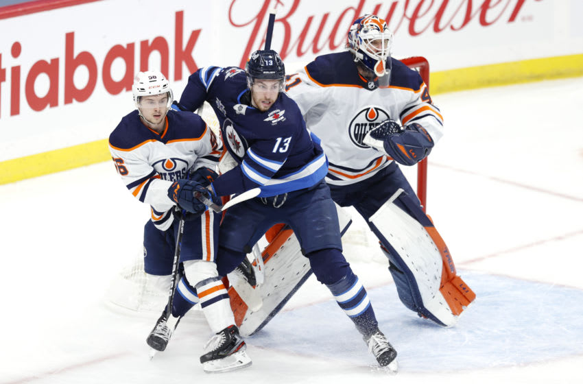Apr 17, 2021; Winnipeg, Manitoba, CAN; Edmonton Oilers right wing Kailer Yamamoto (56) and Winnipeg Jets left wing Pierre-Luc Dubois (13) tangle in front of Edmonton Oilers goaltender Mike Smith (41) in the first period at Bell MTS Place. Mandatory Credit: James Carey Lauder-USA TODAY Sports