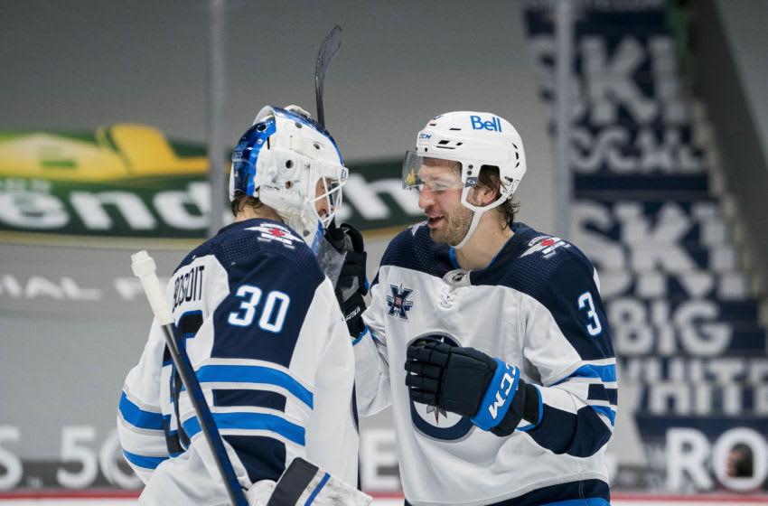 Winnipeg Jets, Laurent Brossoit #30, Tucker Poolman #3, (Mandatory Credit: Bob Frid-USA TODAY Sports)