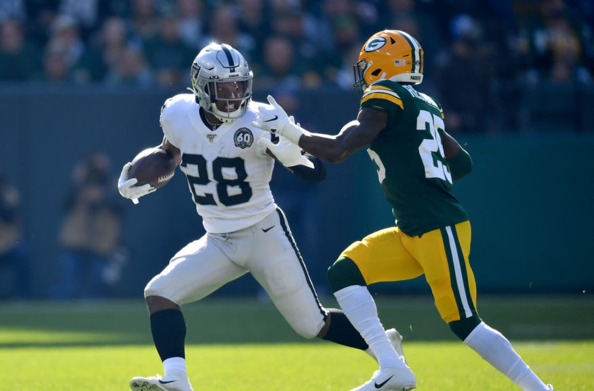 GREEN BAY, WISCONSIN - OCTOBER 20: Josh Jacobs #28 of the Oakland Raiders runs with the football in the first quarter against Will Redmond #25 of the Green Bay Packers at Lambeau Field on October 20, 2019 in Green Bay, Wisconsin. (Photo by Quinn Harris/Getty Images)