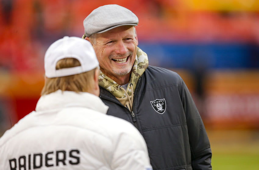 KANSAS CITY, MO - DECEMBER 01: Oakland Raiders general manager Mike Mayock smiles while talking with Raiders owner Mark Davis prior to the game against the Kansas City Chiefs at Arrowhead Stadium on December 1, 2019 in Kansas City, Missouri. (Photo by David Eulitt/Getty Images)