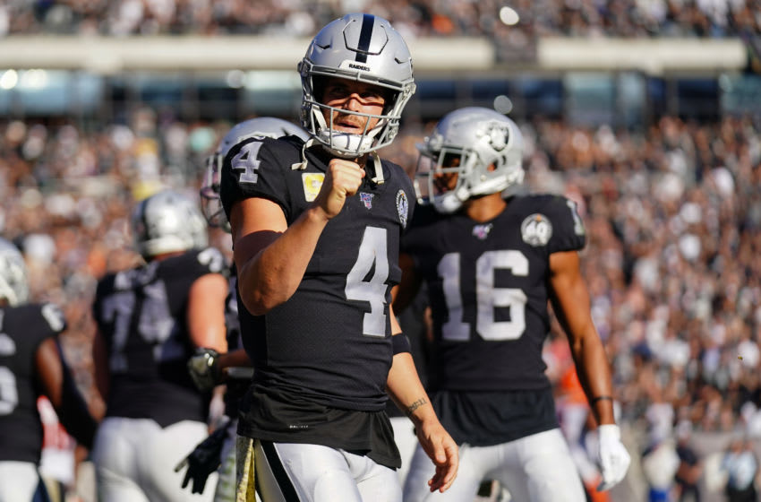 OAKLAND, CALIFORNIA - NOVEMBER 17: Derek Carr #4 of the Oakland Raiders reacts to throwing a touchdown pass during the first half against the Cincinnati Bengals at RingCentral Coliseum on November 17, 2019 in Oakland, California. (Photo by Daniel Shirey/Getty Images)