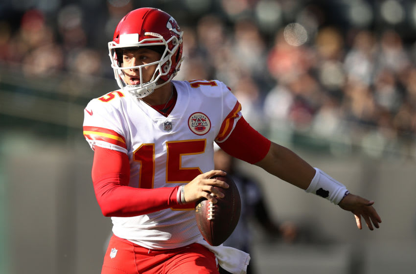 OAKLAND, CA - DECEMBER 02: Patrick Mahomes #15 of the Kansas City Chiefs scrambles with the ball against the Oakland Raiders during their NFL game at Oakland-Alameda County Coliseum on December 2, 2018 in Oakland, California. (Photo by Ezra Shaw/Getty Images)