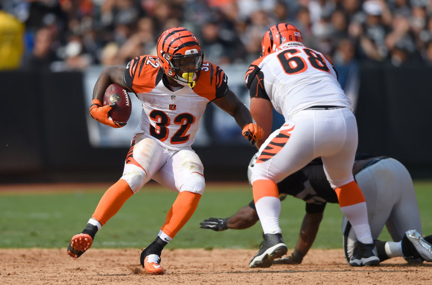 OAKLAND, CA - SEPTEMBER 13: Jeremy Hill #32 of the Cincinnati Bengals carries the ball against the Oakland Raiders during their NFL game at the O.co Coliseum on September 13, 2015 in Oakland, California. (Photo by Thearon W. Henderson/Getty Images)