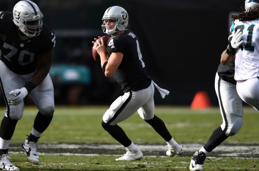 OAKLAND, CA - NOVEMBER 27: Derek Carr #4 of the Oakland Raiders looks to pass against the Carolina Panthers during their NFL game on November 27, 2016 in Oakland, California. (Photo by Thearon W. Henderson/Getty Images)