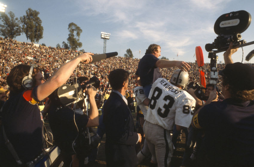 PASADENA, CA- JANUARY 9: Head Coach John Madden of the Oakland Raiders gets carried off the field by Ted Hendricks #83 and John Matuszak #72 after they defeated the Minnesota Vikings in Super Bowl XI on January 9, 1977 at the Rose Bowl in Pasadena, California. The Raiders won the Super Bowl 32 -14. (Photo by Focus on Sport/Getty Images)
