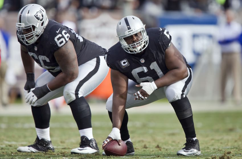 OAKLAND, CA - DECEMBER 4: Center Rodney Hudson No. 61 and guard Gabe Jackson No. 66 of the Oakland Raiders prepare to snap the ball in the second quarter on December 4, 2016 at Oakland-Alameda County Coliseum in Oakland, California. The Raiders won 38-24. (Photo by Brian Bahr/Getty Images)
