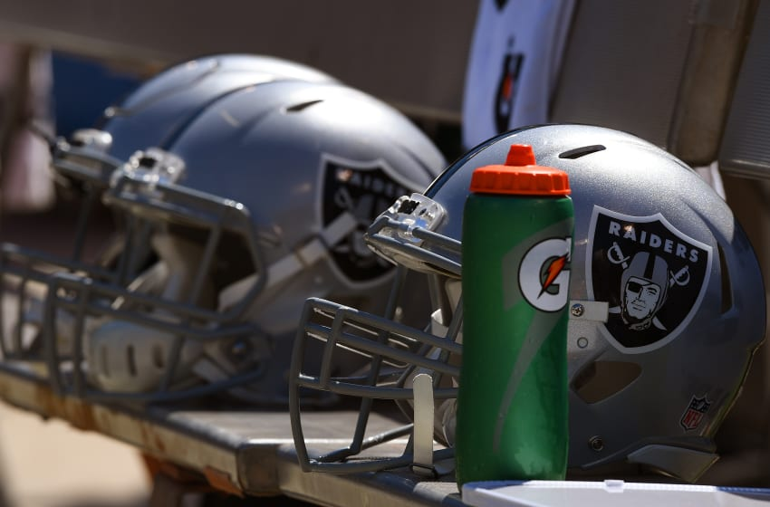 OAKLAND, CA - SEPTEMBER 18: A detailed view of Oakland Raiders helmets sitting on the bench during the National Anthem prior to their game against the Atlanta Falcons at Oakland-Alameda County Coliseum on September 18, 2016 in Oakland, California. (Photo by Thearon W. Henderson/Getty Images)