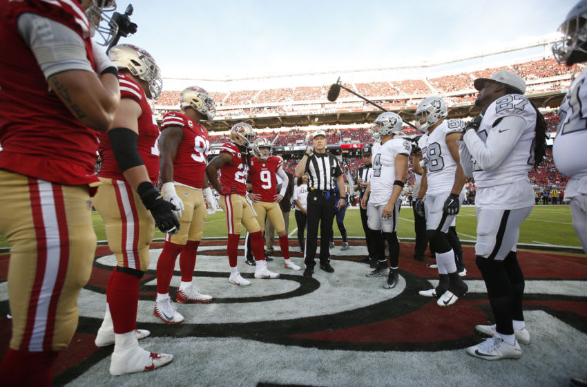 SANTA CLARA, CA - NOVEMBER 1: Captains of the San Francisco 49ers and the Oakland Raiders meet at midfield for the coin toss prior to the game at Levi's Stadium on November 1, 2018 in Santa Clara, California. The 49ers defeated the Raiders 34-3. (Photo by Michael Zagaris/San Francisco 49ers/Getty Images)