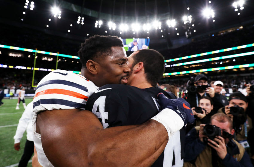 LONDON, ENGLAND - OCTOBER 06: Derek Carr #4 of the Oakland Raiders (R) embraces Khalil Mack #52 of the Chicago Bears following the match between the Chicago Bears and Oakland Raiders at Tottenham Hotspur Stadium on October 06, 2019 in London, England. (Photo by Jack Thomas/Getty Images)