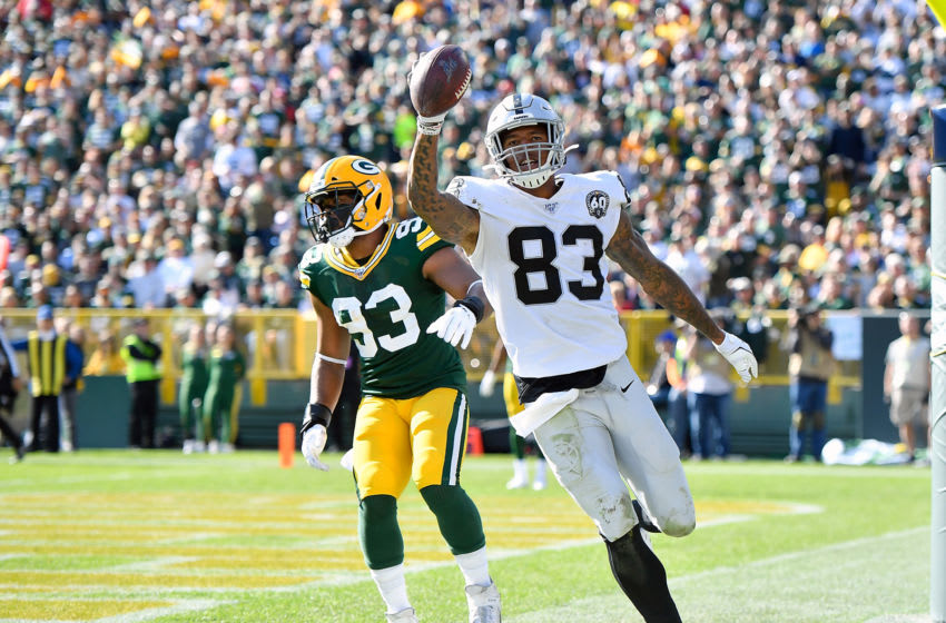 GREEN BAY, WISCONSIN - OCTOBER 20: Darren Waller #83 of the Oakland Raiders scores a touchdown in the second half against the Oakland Raiders at Lambeau Field on October 20, 2019 in Green Bay, Wisconsin. (Photo by Quinn Harris/Getty Images)