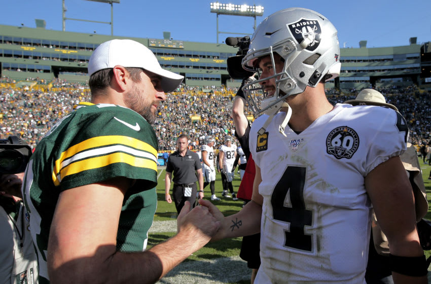 GREEN BAY, WISCONSIN - OCTOBER 20: Aaron Rodgers #12 of the Green Bay Packers and Derek Carr #4 of the Oakland Raiders meet after the Packers beat the Raiders 42-24 at Lambeau Field on October 20, 2019 in Green Bay, Wisconsin. (Photo by Dylan Buell/Getty Images)