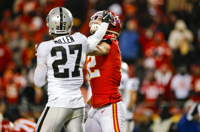 KANSAS CITY, MO - DECEMBER 01: Trayvon Mullen #27 of the Oakland Raiders pushes the face mask of Gehrig Dieter #12 of the Kansas City Chiefs, resulting in a personal foul penalty in the fourth quarter at Arrowhead Stadium on December 1, 2019 in Kansas City, Missouri. (Photo by David Eulitt/Getty Images)