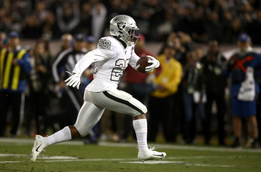 OAKLAND, CALIFORNIA - NOVEMBER 07: Josh Jacobs #28 of the Oakland Raiders runs the ball in for the winning touchdown against the Los Angeles Chargers in the fourth quarter at RingCentral Coliseum on November 07, 2019 in Oakland, California. (Photo by Ezra Shaw/Getty Images)