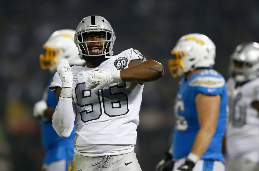OAKLAND, CALIFORNIA - NOVEMBER 07: Clelin Ferrell #96 of the Oakland Raiders celebrates after sacking quarterback Philip Rivers #17 of the Los Angeles Chargers in the fourth quarter at RingCentral Coliseum on November 07, 2019 in Oakland, California. (Photo by Lachlan Cunningham/Getty Images)