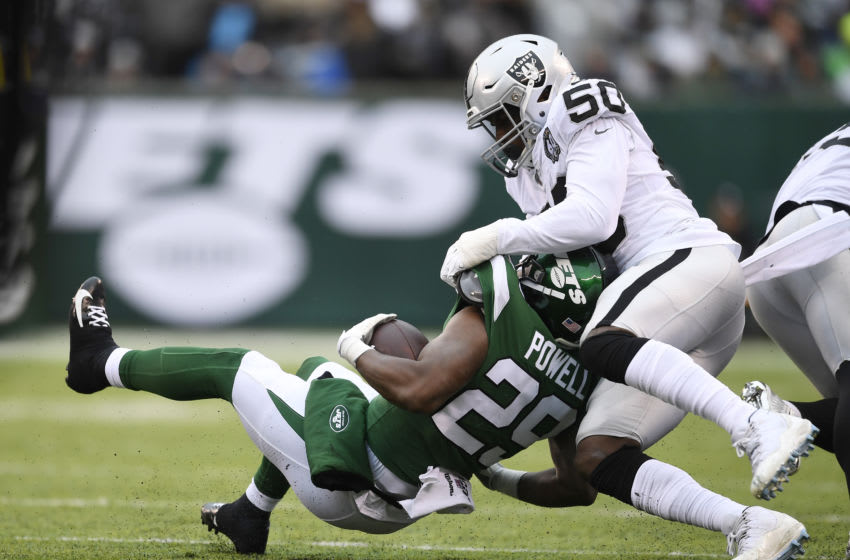 EAST RUTHERFORD, NEW JERSEY - NOVEMBER 24: Linebacker Nicholas Morrow #50 of the Oakland Raiders tackles running back Bilal Powell #29 of the New York Jets during the first half of the game at MetLife Stadium on November 24, 2019 in East Rutherford, New Jersey. (Photo by Sarah Stier/Getty Images)