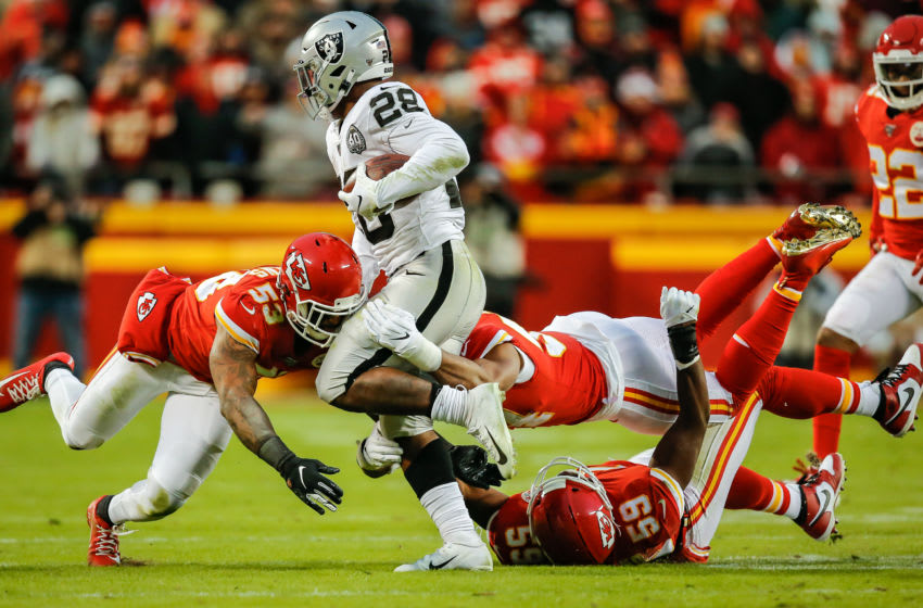 KANSAS CITY, MO - DECEMBER 01: Damien Wilson #54 of the Kansas City Chiefs and Anthony Hitchens #53 of the Kansas City Chiefs combine on a tackle of Josh Jacobs #28 of the Oakland Raiders during the second quarter at Arrowhead Stadium on December 1, 2019 in Kansas City, Missouri. (Photo by David Eulitt/Getty Images)
