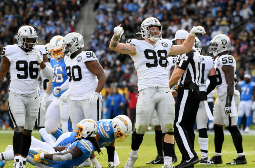 CARSON, CALIFORNIA - DECEMBER 22: Maxx Crosby #98 of the Oakland Raiders celebrates his stop of Melvin Gordon #25 of the Los Angeles Chargers during the second quarter at Dignity Health Sports Park on December 22, 2019 in Carson, California. (Photo by Harry How/Getty Images)
