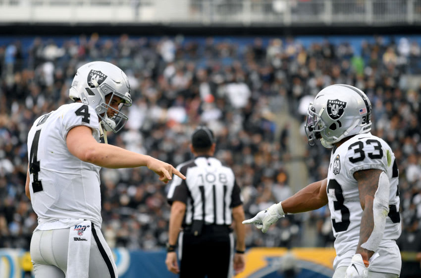CARSON, CALIFORNIA - DECEMBER 22: Derek Carr #4 of the Oakland Raiders celebrates the touchdown of DeAndre Washington #33, to take a 21-7 lead over the Los Angeles Chargers, during the third quarter at Dignity Health Sports Park on December 22, 2019 in Carson, California. (Photo by Harry How/Getty Images)