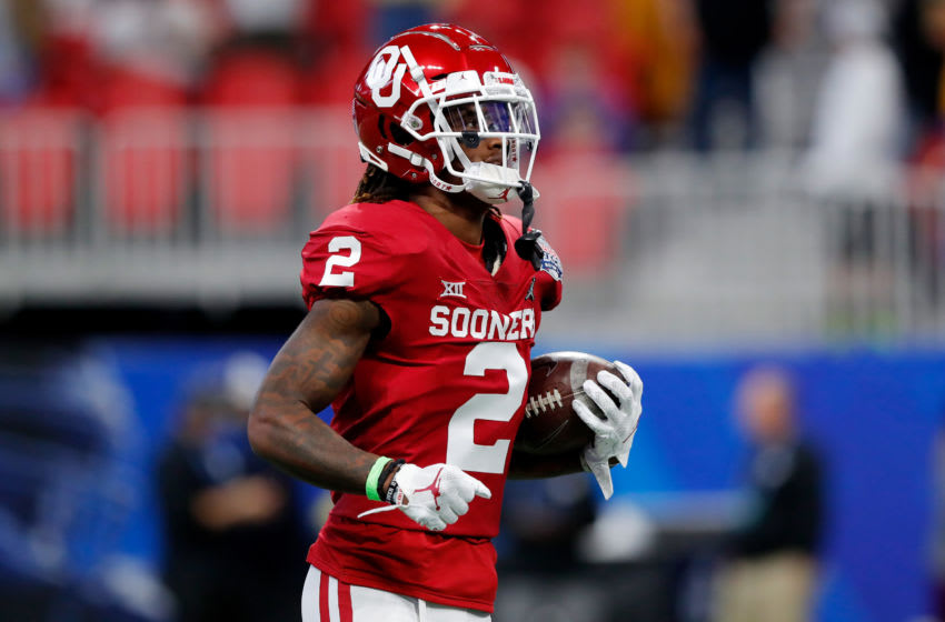ATLANTA, GEORGIA - DECEMBER 28: Wide receiver CeeDee Lamb #2 of the Oklahoma Sooners warms up before the game against the LSU Tigers in the Chick-fil-A Peach Bowl at Mercedes-Benz Stadium on December 28, 2019 in Atlanta, Georgia. (Photo by Kevin C. Cox/Getty Images)