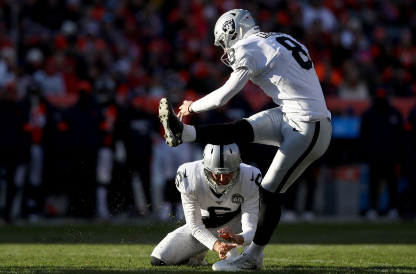 DENVER, COLORADO - DECEMBER 29: AJ Cole #6 holds as Daniel Carlson #8 of the Oakland Raiders kicks a field goal against the Denver Broncos in the second quarter at Empower Field at Mile High on December 29, 2019 in Denver, Colorado. (Photo by Matthew Stockman/Getty Images)