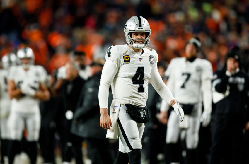 DENVER, CO - DECEMBER 29: Quarterback Derek Carr #4 of the Oakland Raiders walks on the field against the Denver Broncos during the fourth quarter at Empower Field at Mile High on December 29, 2019 in Denver, Colorado. The Broncos defeated the Raiders 16-15. (Photo by Justin Edmonds/Getty Images)