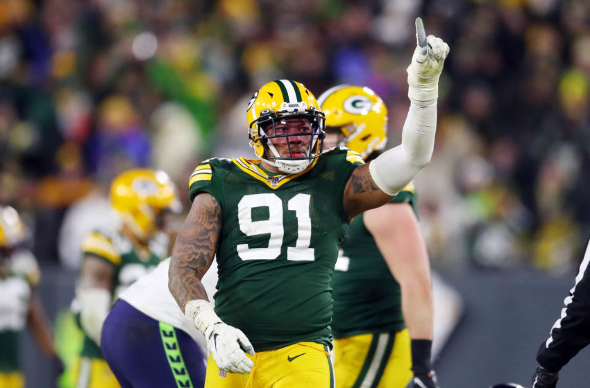 GREEN BAY, WISCONSIN - JANUARY 12: Preston Smith #91 of the Green Bay Packers celebrates after sacking Russell Wilson #3 of the Seattle Seahawks (not pictured) during the fourth quarter in the NFC Divisional Playoff game at Lambeau Field on January 12, 2020 in Green Bay, Wisconsin. (Photo by Gregory Shamus/Getty Images)