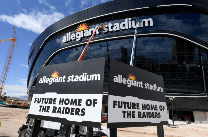 LAS VEGAS, NEVADA - MARCH 17: Workers adjust the newly installed sign at Allegiant Stadium as construction continues at the USD 2 billion, glass-domed future home of the Las Vegas Raiders on March 17, 2020 in Las Vegas, Nevada. The Raiders and the UNLV Rebels football teams are scheduled to begin play at the 65,000-seat facility in their 2020 seasons. (Photo by Ethan Miller/Getty Images)
