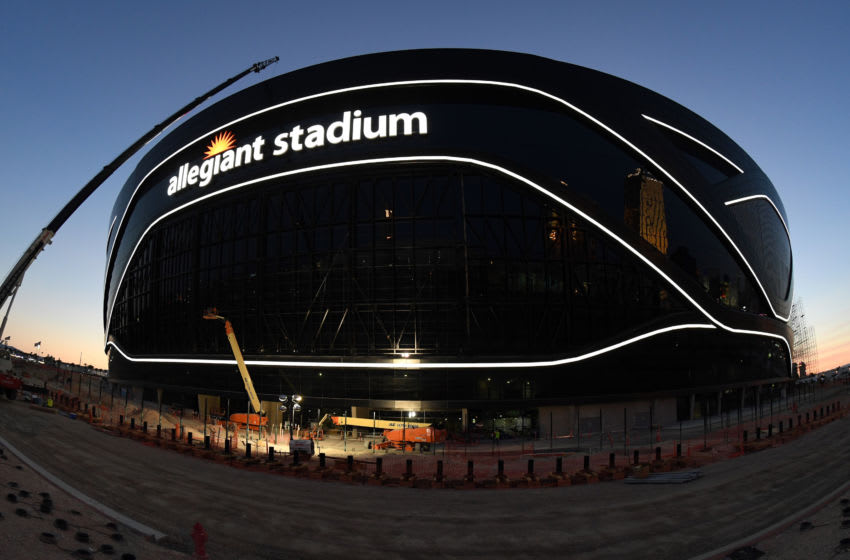 LAS VEGAS, NEVADA - APRIL 23: (EDITORS NOTE: This image was shot with a fisheye lens.) Crews test out architectural light ribbons and exterior sign lighting as construction continues at Allegiant Stadium, the USD 2 billion, glass-domed future home of the Las Vegas Raiders on April 23, 2020 in Las Vegas, Nevada. The Raiders and the UNLV Rebels football teams are scheduled to begin play at the 65,000-seat facility in their 2020 seasons. (Photo by Ethan Miller/Getty Images)