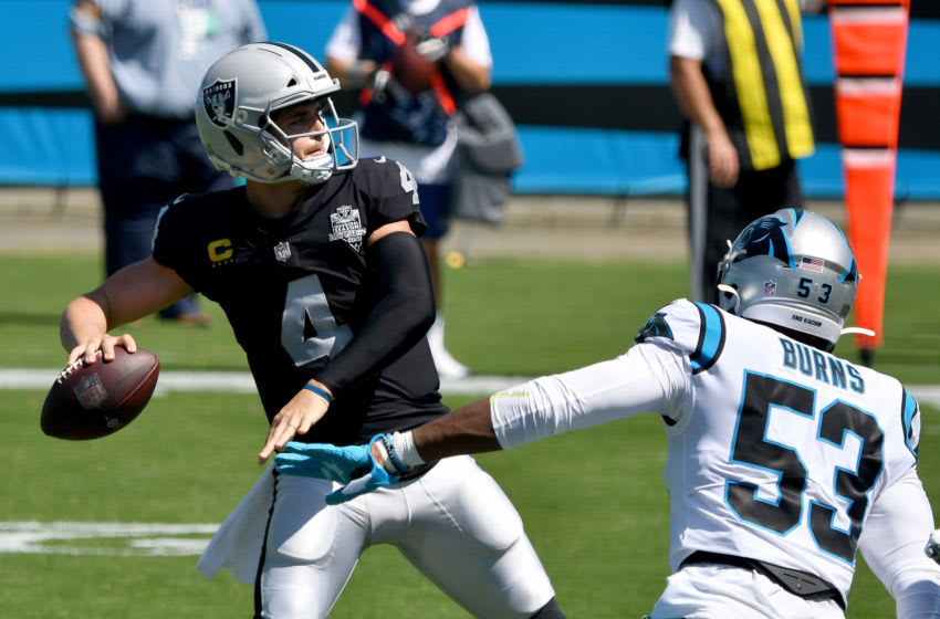 CHARLOTTE, NORTH CAROLINA - SEPTEMBER 13: Derek Carr #4 of the Las Vegas Raiders looks to pass under pressure from Brian Burns #53 of the Carolina Panthers in the first quarter at Bank of America Stadium on September 13, 2020 in Charlotte, North Carolina. (Photo by Grant Halverson/Getty Images)