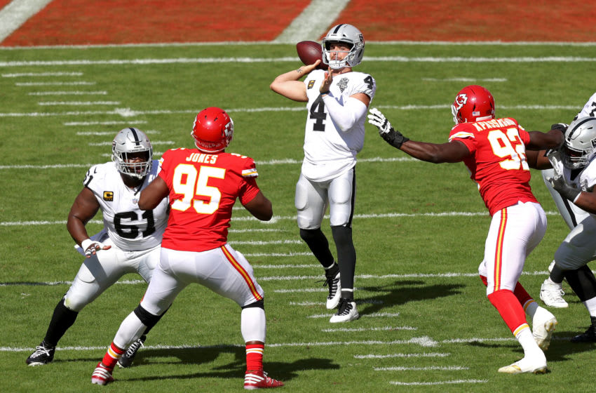 KANSAS CITY, MISSOURI - OCTOBER 11: Derek Carr #4 of the Las Vegas Raiders attempts a pass against the Kansas City Chiefs during the first quarter at Arrowhead Stadium on October 11, 2020 in Kansas City, Missouri. (Photo by Jamie Squire/Getty Images)