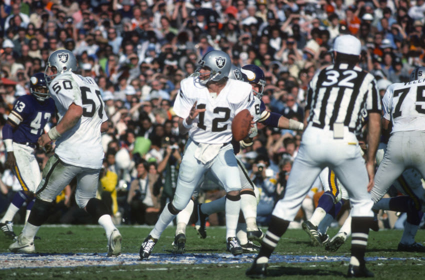 PASADENA, CA- JANUARY 9: Ken Stabler #12 of the Oakland Raiders drops back to pass against the Minnesota Vikings during Super Bowl XI on January 9, 1977 at the Rose Bowl in Pasadena, California. The Raiders won the Super Bowl 32 -14. (Photo by Focus on Sport/Getty Images)