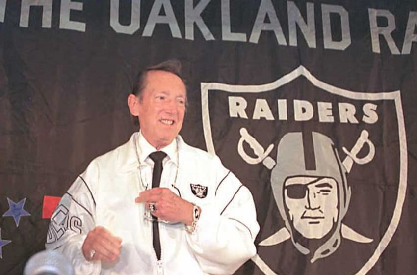 OAKLAND, : Al Davis, the owner of the Oakland Raiders, smiles as he faces reporters and photographers after a press conference at the Oakland Alameda County Coliseum Arena 06 July. Davis has signed an agreement to move the Los Angeles Raiders back to Oakland, California, after leaving 14 years ago. AFP PHOTO (Photo credit should read JOHN G. MABANGLO/AFP via Getty Images)