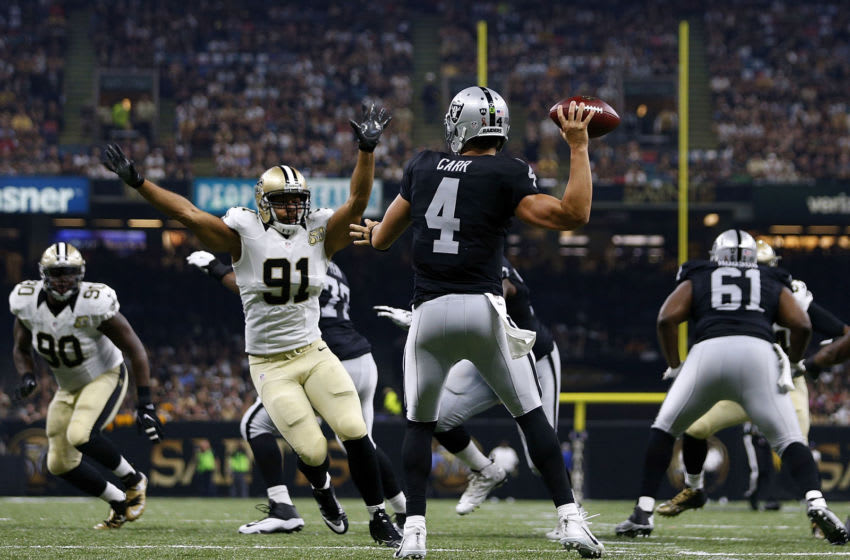 NEW ORLEANS, LA - SEPTEMBER 11: Derek Carr #4 of the Oakland Raiders throws the ball as Kasim Edebali #91 of the New Orleans Saints defends during the first half of a game at Mercedes-Benz Superdome on September 11, 2016 in New Orleans, Louisiana. (Photo by Jonathan Bachman/Getty Images)