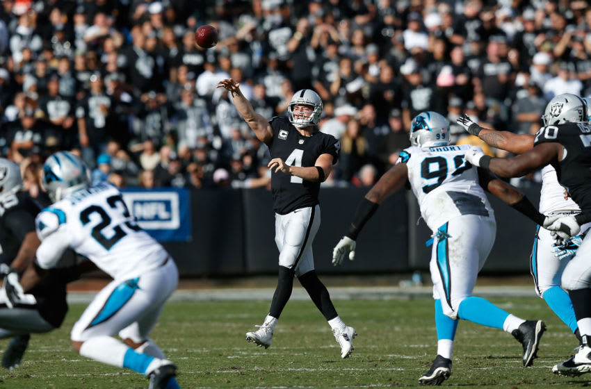 OAKLAND, CA - NOVEMBER 27: Derek Carr #4 of the Oakland Raiders passes the ball in the second quarter against the Carolina Panthers on November 27, 2016 in Oakland, California. (Photo by Lachlan Cunningham/Getty Images)